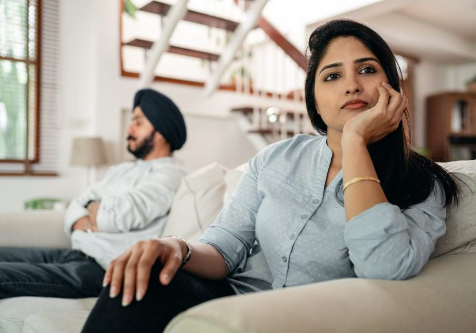 woman in thoughts sitting next to hubby